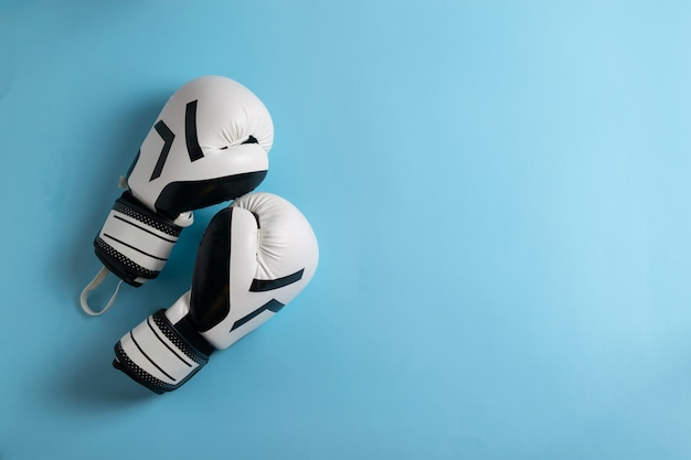 A pair of black and white boxing gloves