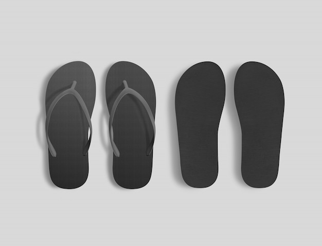 Pair of blank black beach slippers , top view