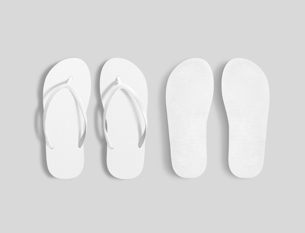 Pair of blank white beach slippers, top view