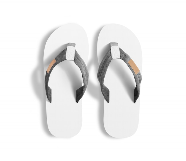 Pair of blank white slippers, design mockup.