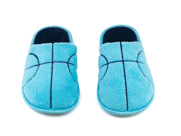 A pair of blue fur slippers isolated on a white . comfortable home shoes. the view from the top.