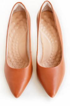 Pair of classic women brown leather heels. fashion footwear. isolated.