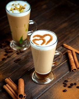 A pair of coffee drinks with milk