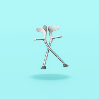 Pair of crutches on blue background