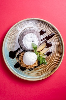 A pair of dessert topped with ice cream _