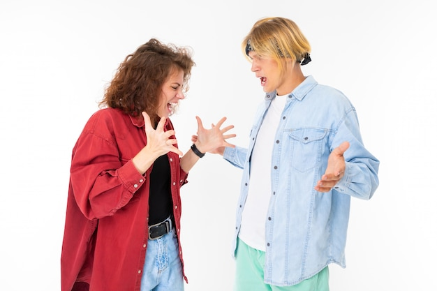 A pair of girls and men in casual clothes swearing on white