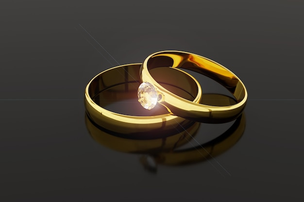 Pair of gold and diamond wedding rings isolated on dark background.