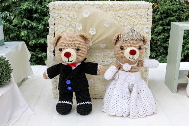 A pair of hand crafter crochet wedding teddy bears