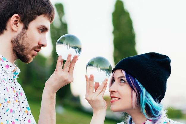 Pair juggles with large transparent balls