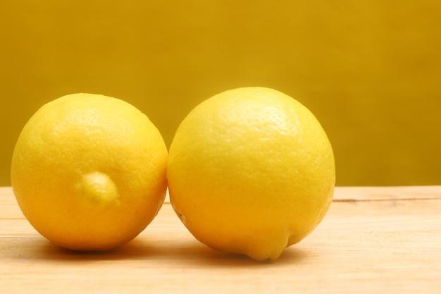 Pair of lemon on the woodentable