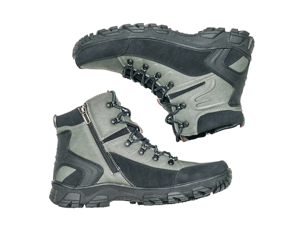 A pair of men's insulated boots isolated on a white surface. casual sports men's shoes.