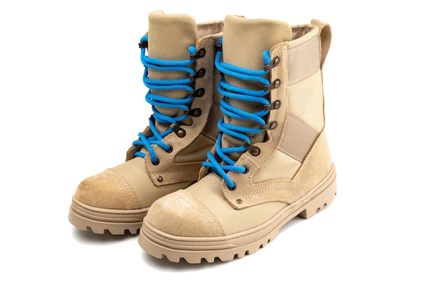 Pair of military boots with blue laces