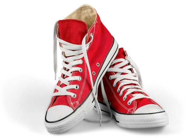 Pair of new red sneakers isolated on white background.