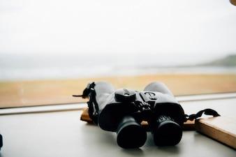 Pair of binoculars on a windowsill