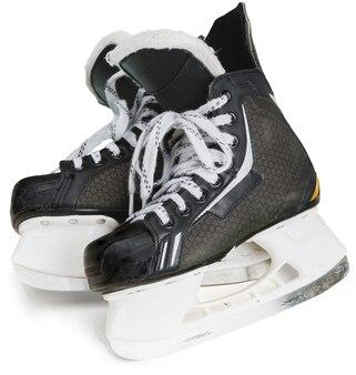 Пара черных хоккейных коньков, изолированные на прозрачном фоне
