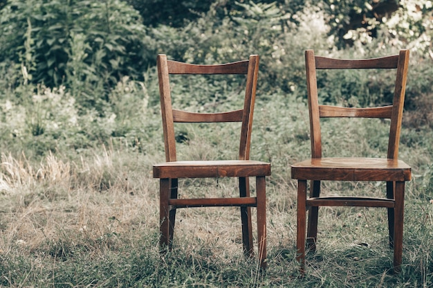 Pair of old wooden chairs outdoors