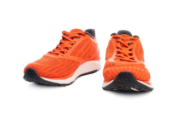 Pair of orange sport sneakers isolated on white