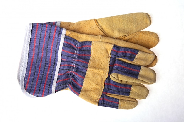 Pair of protective work gloves isolated on a white background.