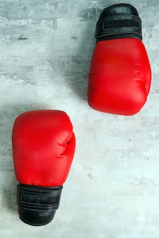 Pair red of boxing gloves on grey