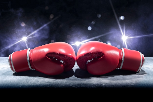 Pair of red boxing gloves on the table