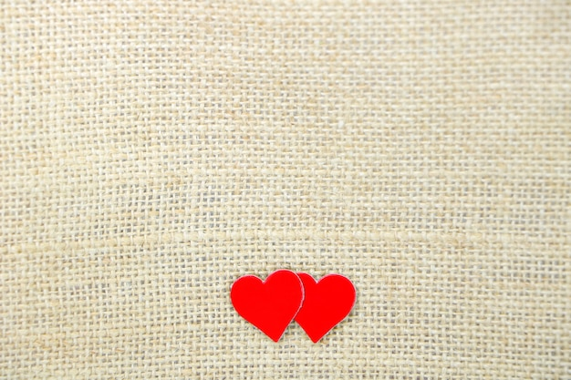 Pair red heart paper on brown sack background have copy space for put text