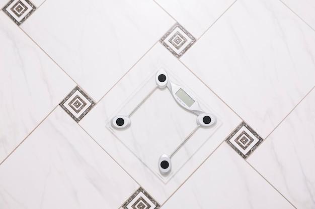 Pair of scales on bathroom floor
