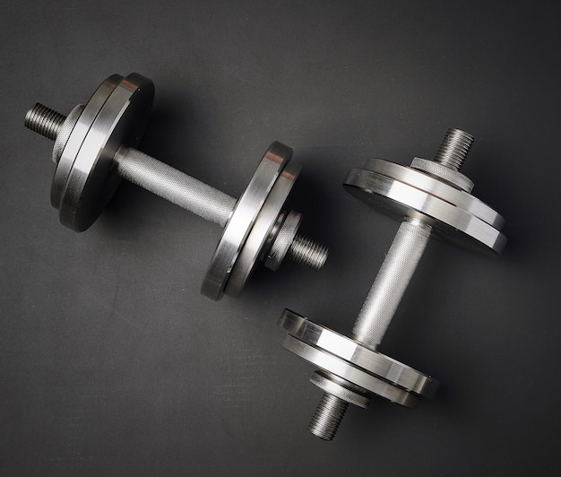 Pair of shiny steel dumbbells for bodybuilding