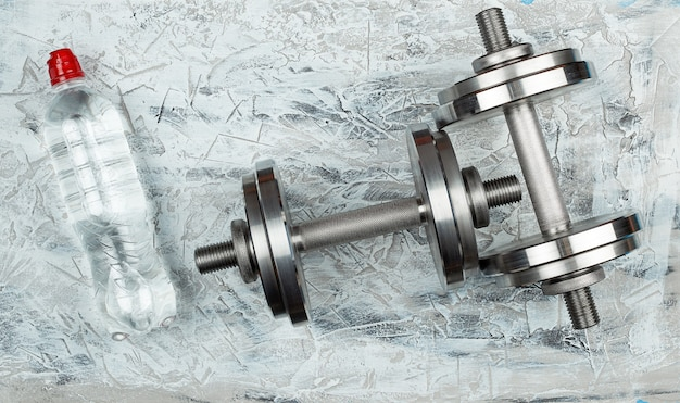Pair of shiny steel typesetting dumbbells for bodybuilding