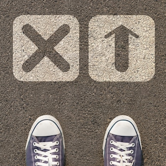 Pair of shoes standing on a road with two icon
