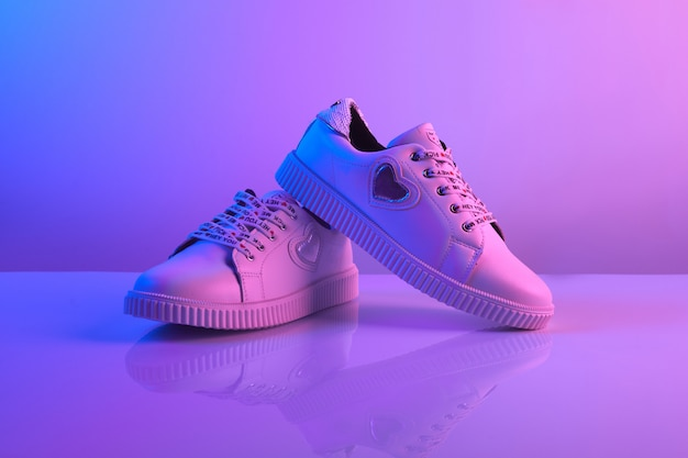 A pair of sneakers in trendy neon light