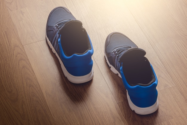Pair of sport shoes on wooden