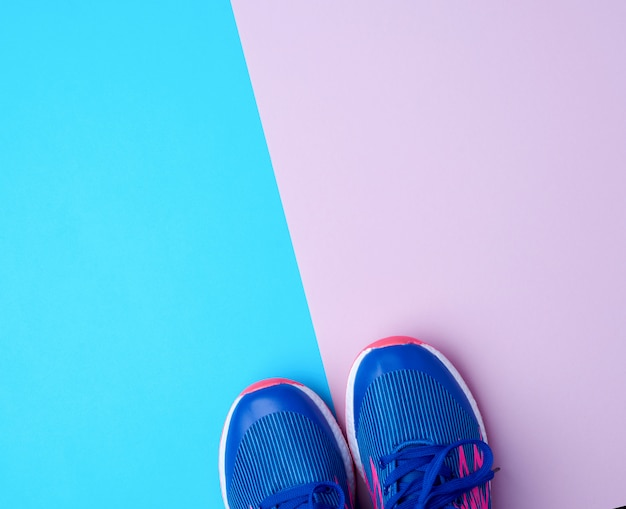 Pair of sports sneakers with blue laces