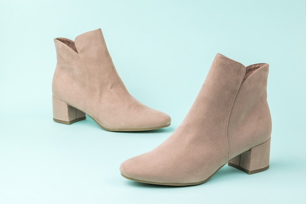 A pair of suede women's half-boots on a light surface
