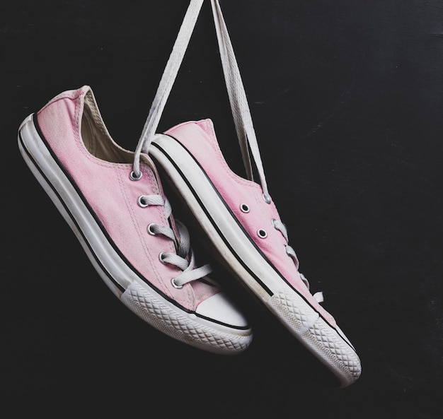 Pair of textile pink sneakers