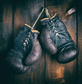Pair of very old brown boxing gloves