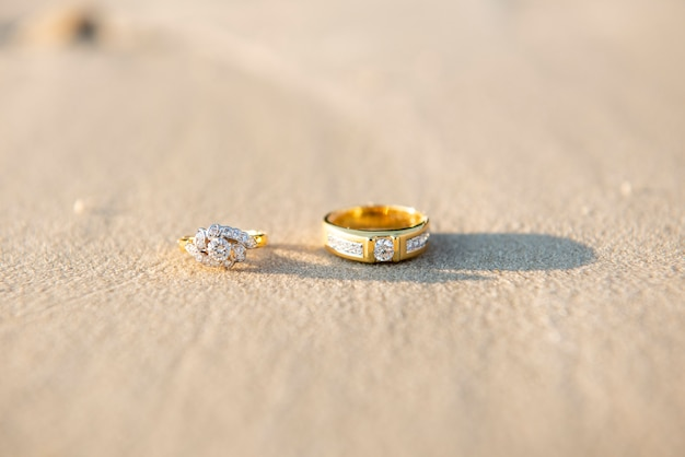 Pair of wedding ring on beach