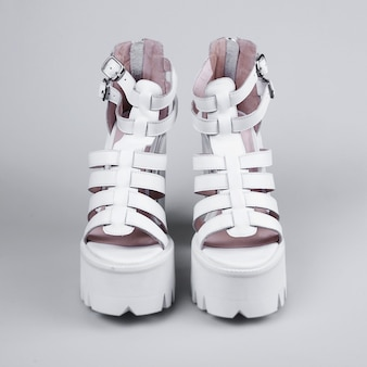 Pair of white high heel shoes