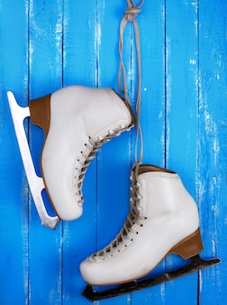 Pair of white leather female skates for figure skating