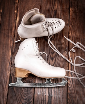 A pair of white leather female skates