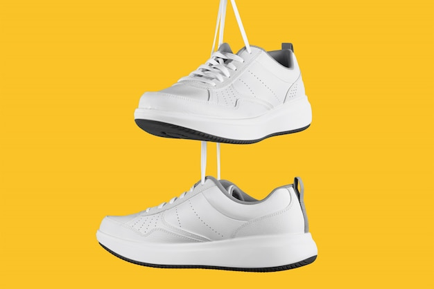 Pair of white male sneakers