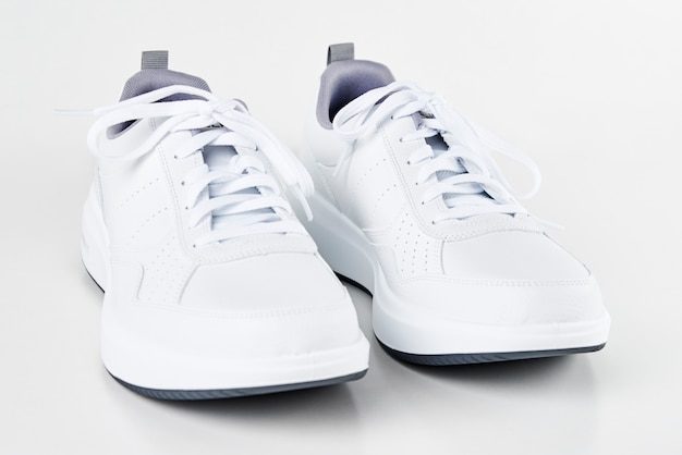 A pair of white male sneakers