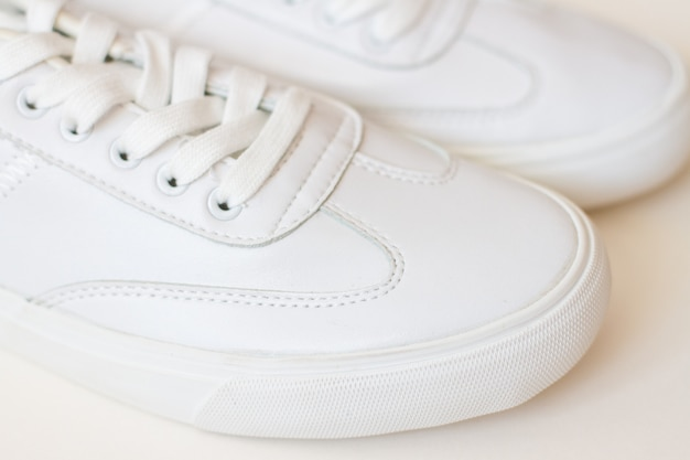 Pair of white sneakers shoes