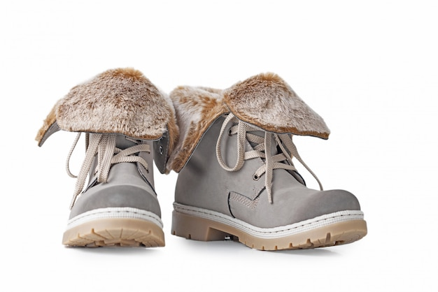 Pair of winter womens boots on white wall isolated