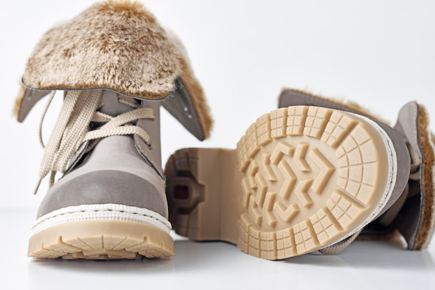Pair of winter womens boots on white