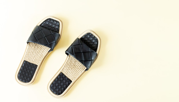 Pair of woman black beach sandals or slippers top view