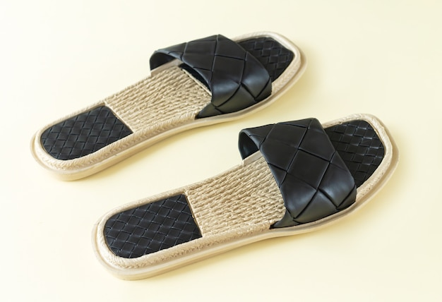 Pair of woman black beach sandals or slippers