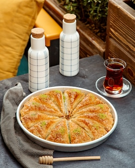 Pakhlava and black tea served in armudu glass