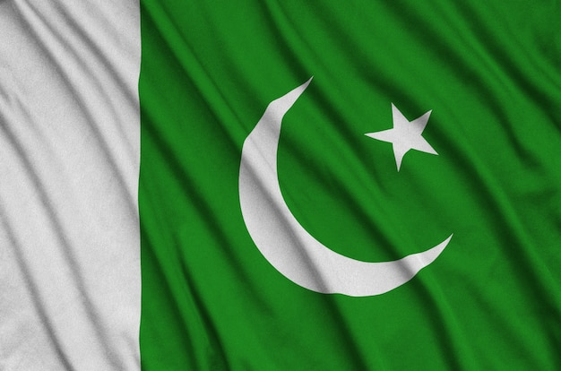 Pakistan flag  is depicted on a sports cloth fabric with many folds.