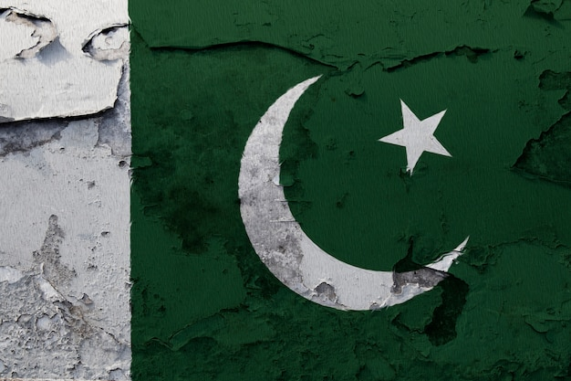 Pakistan flag painted on the cracked concrete wall