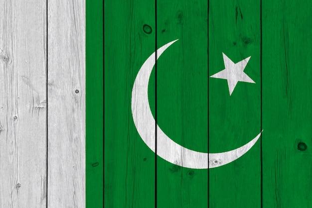 Pakistan flag painted on old wood plank